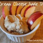 Cream cheese dip in bowl with sliced apples