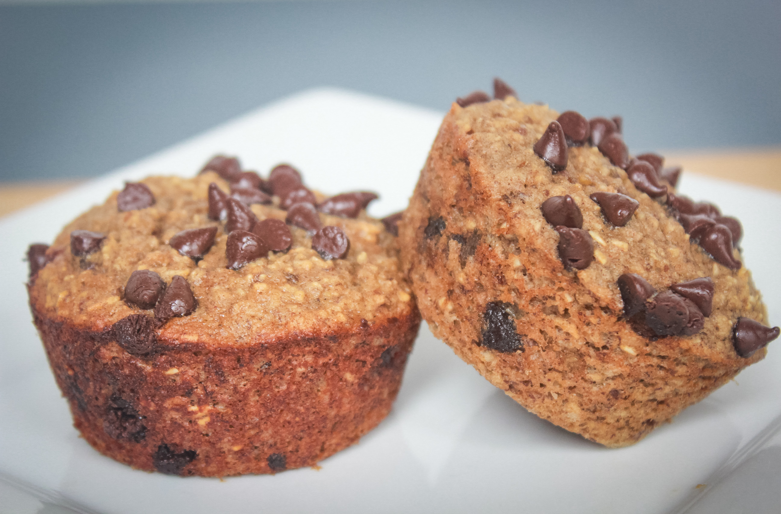 chocolate chip banana oatmeal muffin on white plate