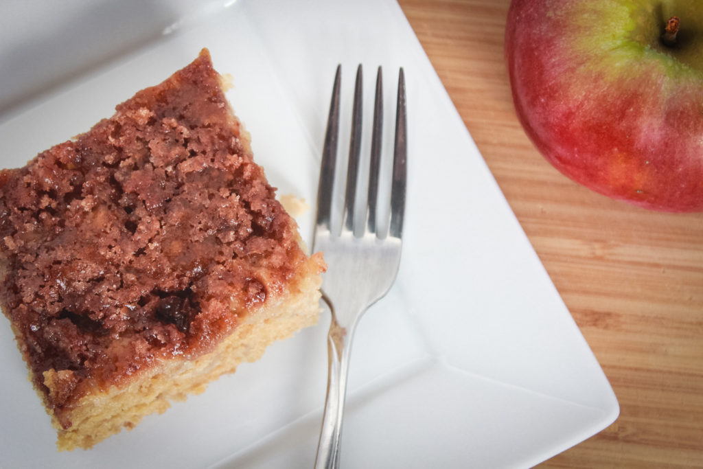 apple cake plated with fork and apple