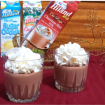 chocolate pudding in cups with whipped topping