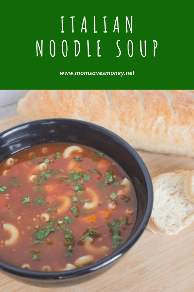 Italian noodle soup in bowl with french bread