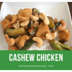 Cashew chicken over rice in a white bowl