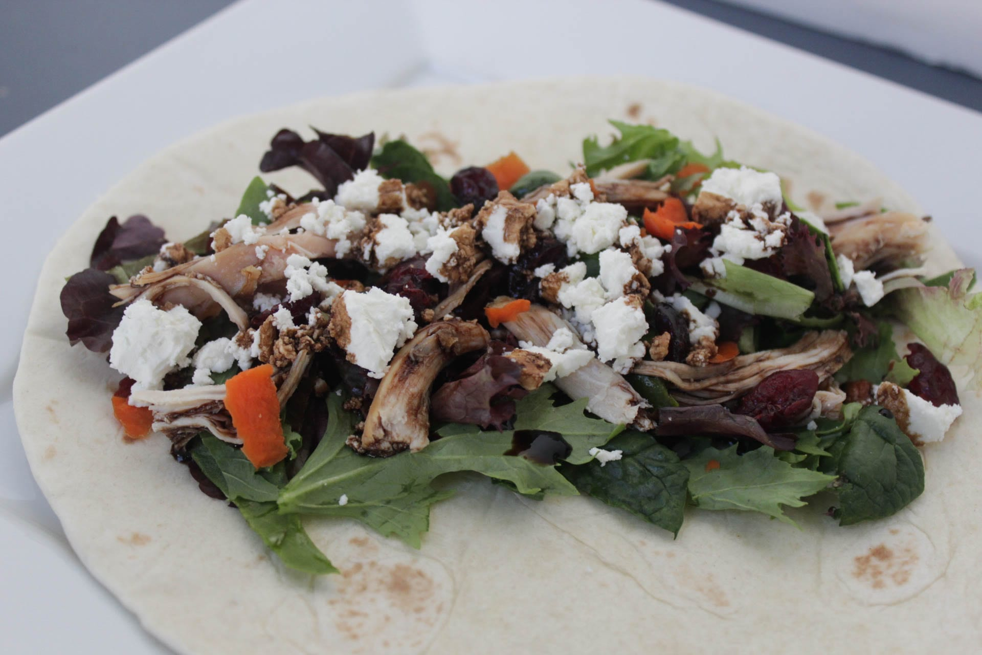 Chicken, greens, goat cheese on tortilla