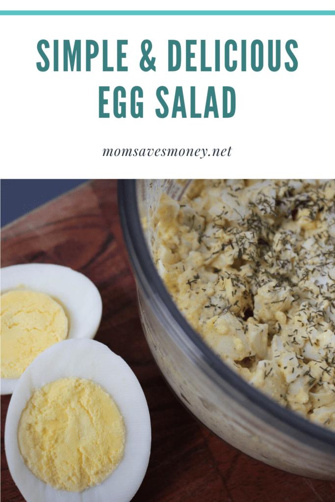 Egg salad in a bowl next to a sliced hard boiled egg