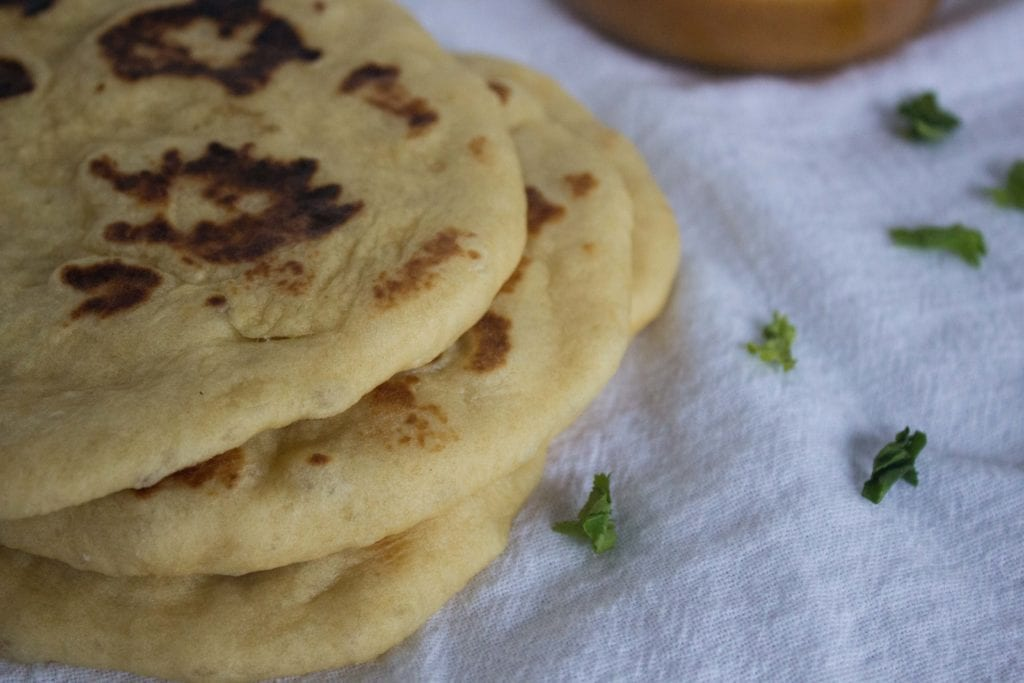 Homemade naan bread on white clothe
