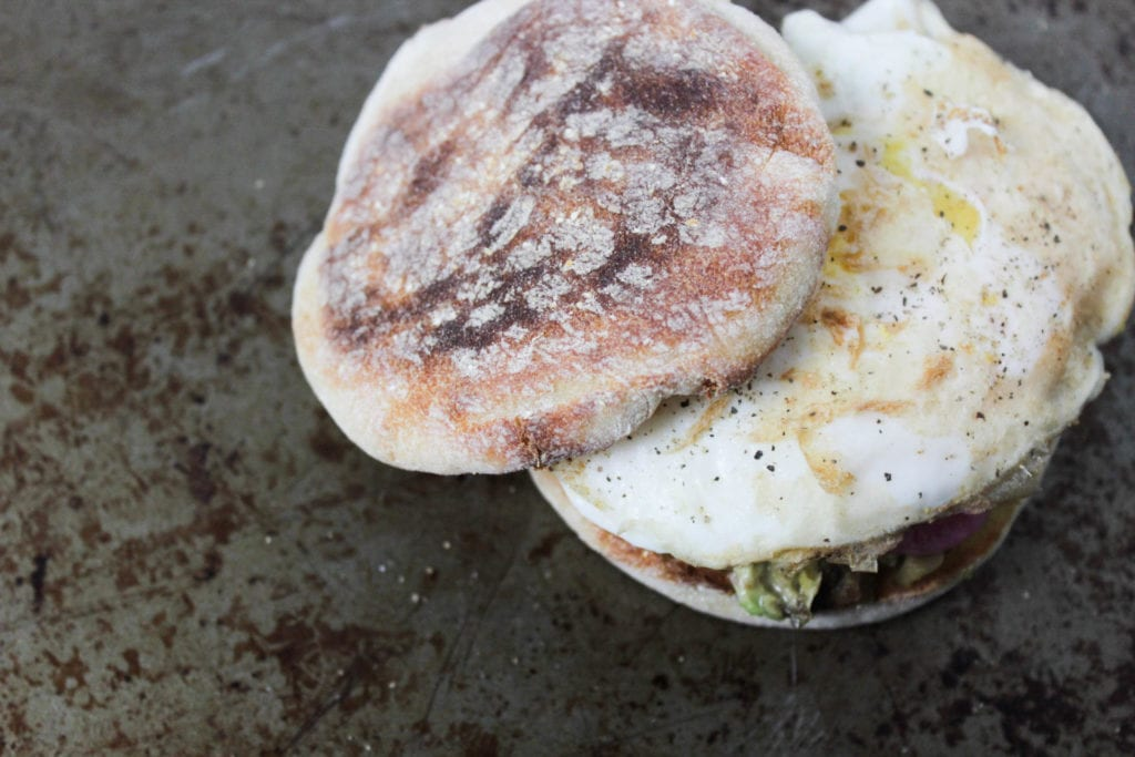 avocado & egg breakfast sandwich on a toasted English muffin
