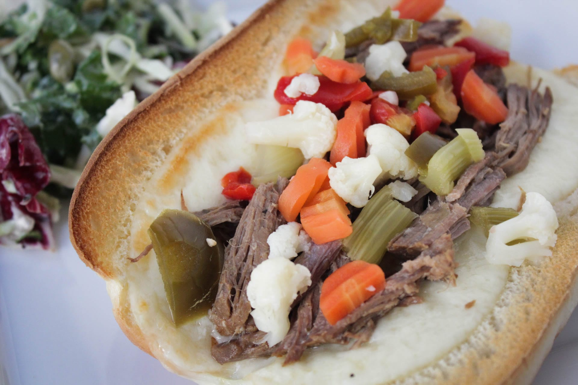 Hot Italian beef sandwiches with provolone cheese and Giardiniera