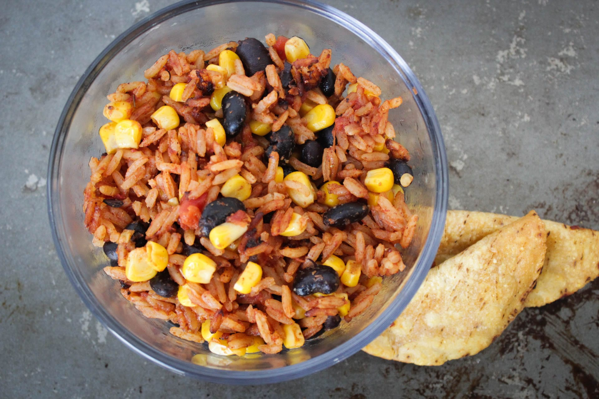 Homemade spanish rice with a blend of flavorful seasonings, corn, tomatoes, diced green chiles and black beans. Serve with your favorite Mexican dishes