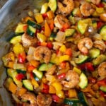Shrimp stir fry with bell peppers, zucchini and onion in a homemade garlic sauce