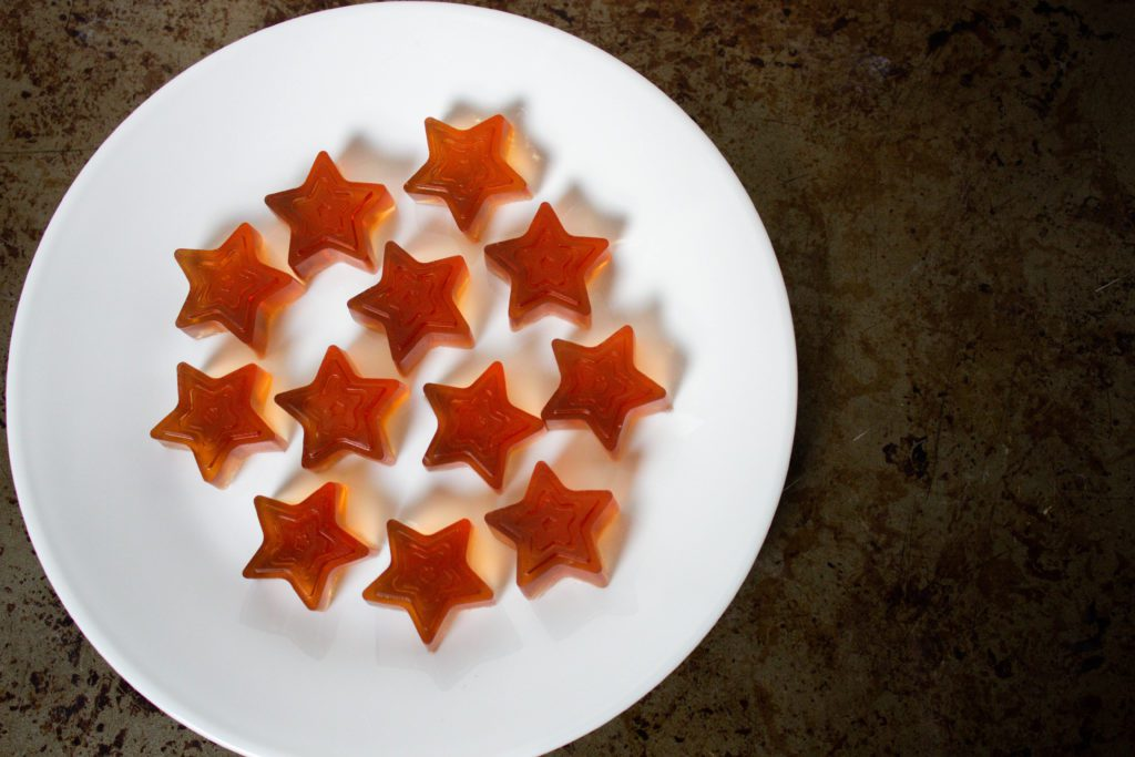 Star shapped homemade gummy candy on a white plate