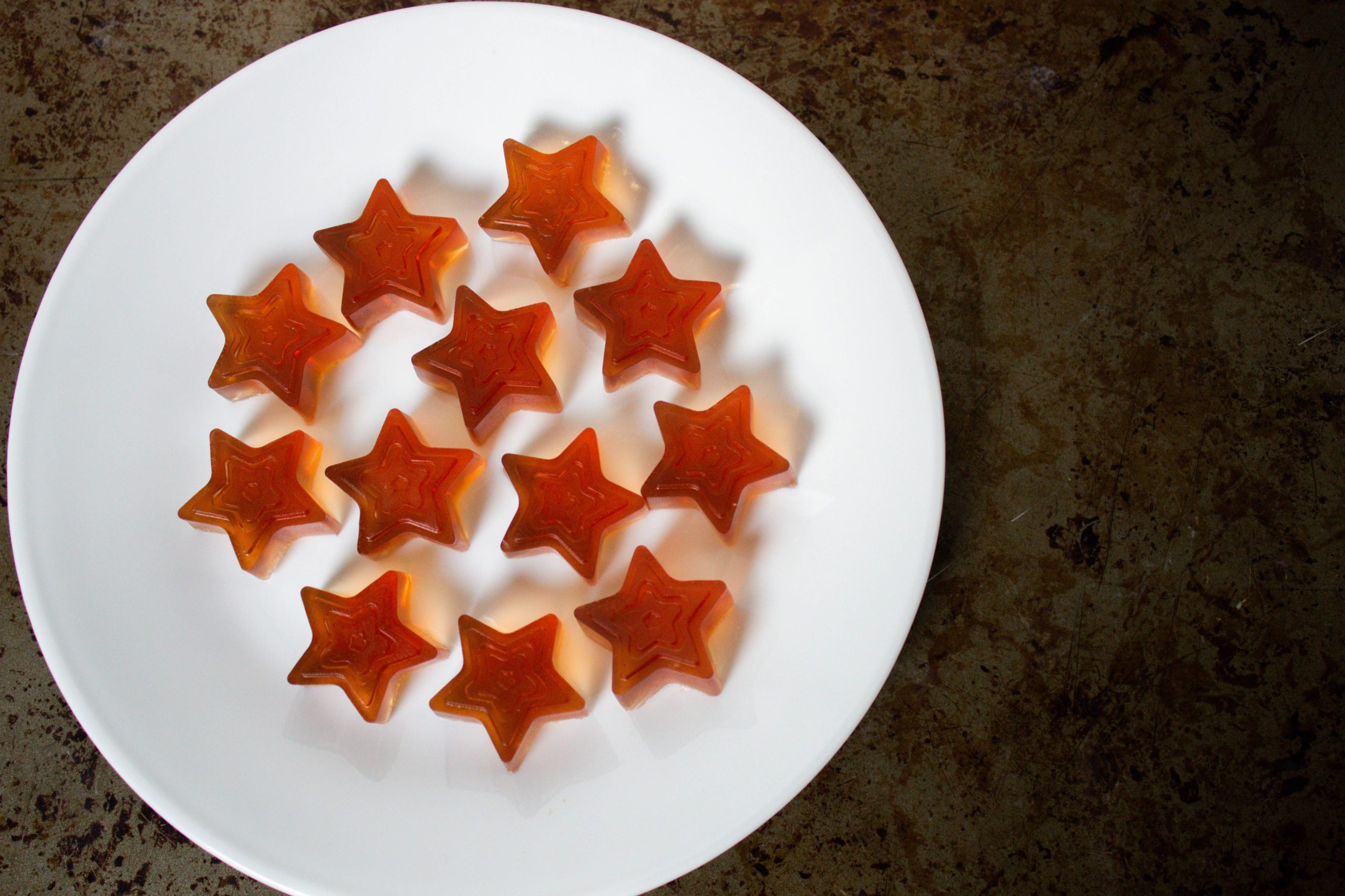 Star-shapped gummy candy on a white plate