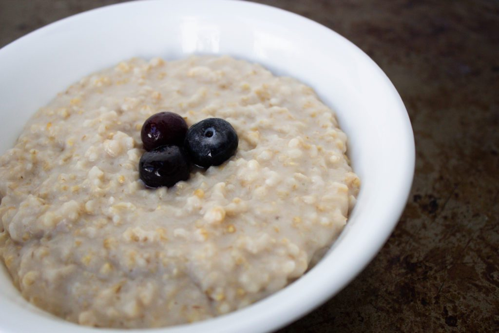 pressure cooked steel cut oats in a white bowl