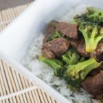 Cooked steak and broccoli with white rice in a bowl
